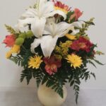 white lily in yellow vase